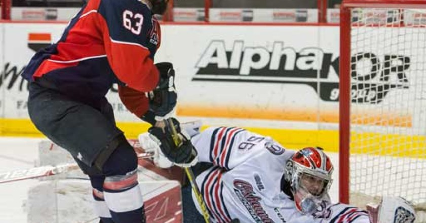 Brad Latour of the Windsor Spitfires scoring on Oshawa